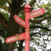 A tall red fingerpost near Chard, Somerset